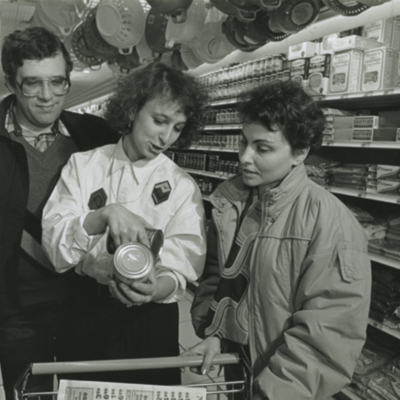 NYANA Staff Assisting Refugees in Supermarket